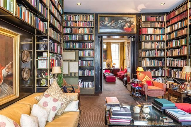 Walls of bookshelves in this bespoke London home.The Peak of Chic®: Lord Weidenfeld and Geoffrey Bennison