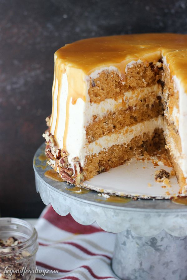 This Salted Caramel Butterscotch cake is a rich butterscotch cake filled with toasted pecans and covered with a brown butter frosting and salted caramel drizzle. from @beyondfrosting