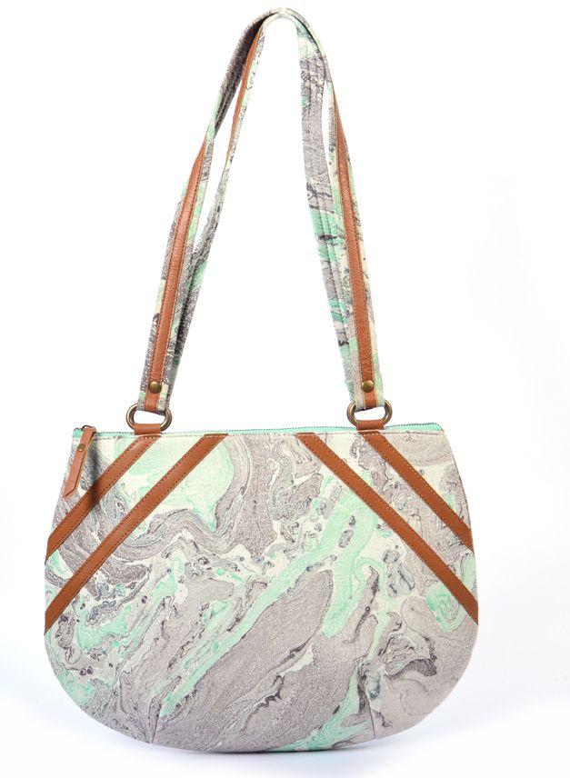 #styleincraft  #buyhandbagsonline #handmadehandbag  An elegant off-white colored canvas work bag with geniuene leather handle. All the elements which go into making a quality product is monitored right from the first stage of leather selection to finishing of the product at their manufacturing facility. An aesthetic print, invaluable artistic skill,