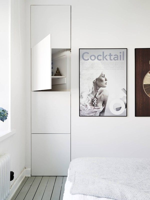 Hidden storage solutions in bright Gothenburg apartment | Scandinavian Deko.
