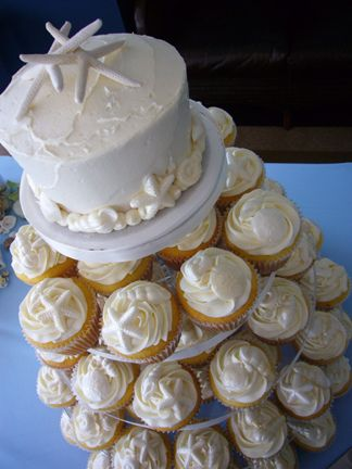 beach mini cake & cupcakes. white on white with white chocolate seashell shapes.
