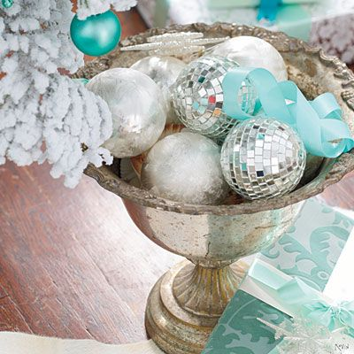 Decorate with Extra Ornaments   Repeat shapes on the Christmas tree that appear in the room. The round ornaments on this tree echo the extra-large curtain                                            rod finials and pom-pom fringe on the pillow. Mini disco balls are tiny reminders of the topper