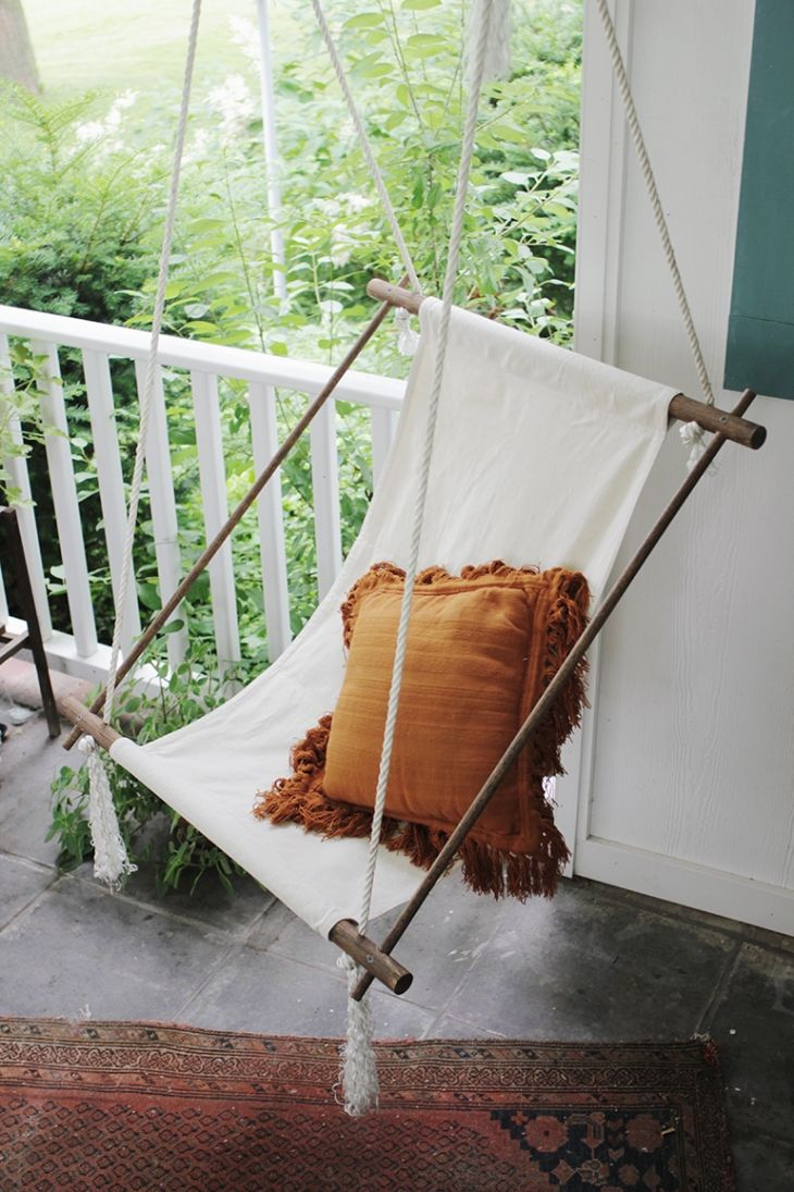 This DIY Hanging Lounge Chair is the perfect seat for some summer lounging, magazine reading, and lemonade sipping. Get the complete how-to from @themerrythought