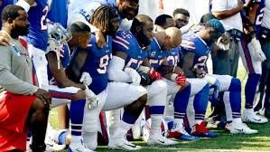 New York Giants football players kneel during national anthem in protest of police brutality and in protest of Donald Trump. (September 24, 2017)