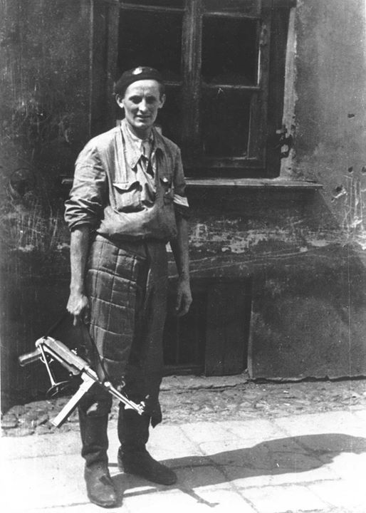 Polish resistance fighter Roman Marchel posing with a captured MP 40 submachine gun during the Warsaw Uprising  Warsaw Poland 20 August 1944.