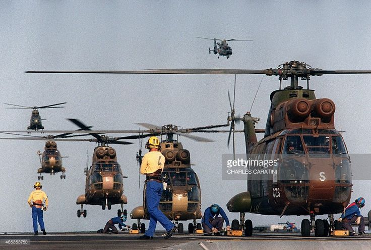 Puma type helicopters of French armed forces land 28 August 1990 on the deck of the aircraft carrier Clemenceau sailing towards the Persian Gulf during the Gulf War. Iraq's invasion of Kuwait 02 August 1990, ostensibly over violations of the Iraqi border, led to the Gulf War which began 16 January 1991. A US-led multi-national force expelled Iraq from Kuwait during the 'Desert Storm' offensive and a cease-fire was signed 28 February 1991.