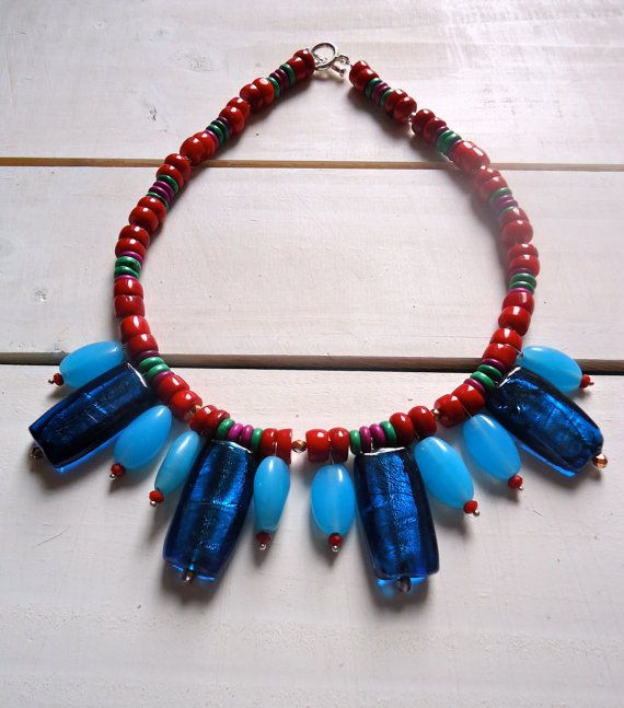 Toffee Wrapper Blues: A bold hand threaded statement necklace in Red Coral, Indian blue glass and Semi Precious Stones
