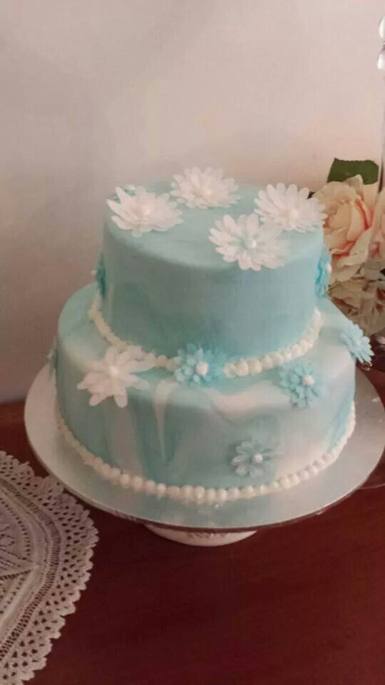 White chocolate mud cake with a Strawberry and raspberry mousse filling.  Decorated with gluten free edible rice paper flowers. Happy bridal shower to Shari.