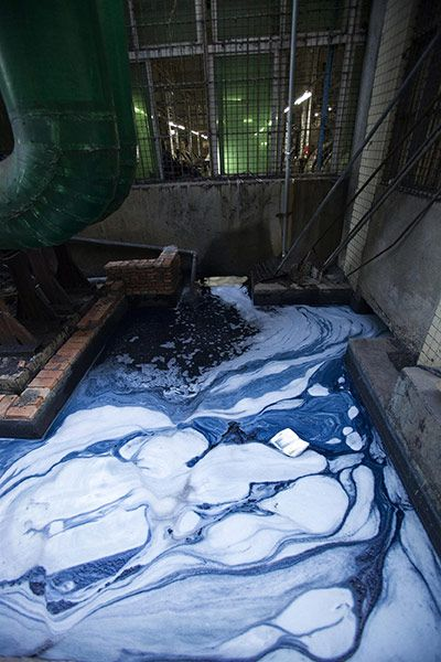 Wastewater discharged from a denim washing factory in Xintang. Villagers complain about the printing and dyeing factories' wastewater that discharges into the local river, which in turn flows into the Pearl River delta