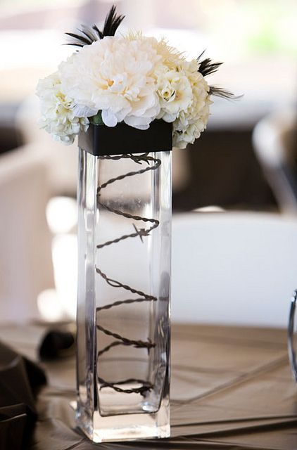 Barbwire Western themed wedding centerpiece ideas- totally cute!  http://2744.mtravel.com/  We can coordinate your destination wedding/honeymoon travel for you so you can be stress free and enjoy!