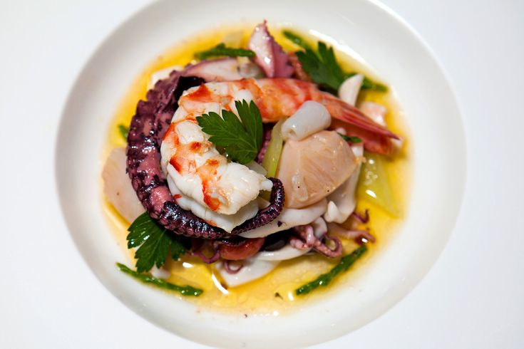 Sauteed scallops, shrimp, calamari, octopus, served with sea beans and lemon colatura. Danny Ghitis for New York Times