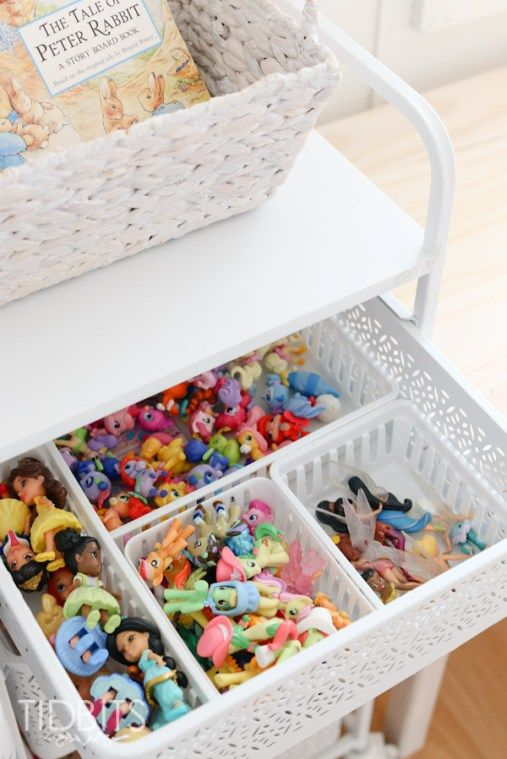 Small organizers inside a bin; brilliant! Especially for all those tiny toy accessories. As seen on: Girls shared room and simple organizational ideas for a small bedroom