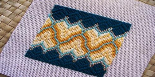 Day 51: Florentine Hearts Border Challenge Design - Heart-shaped motifs fit together to form a Florentine embroidery border in this Bargello needlepoint design that's found on pp. 112-113 in Bargello: An Explosion In Color by Margaret Boyles.