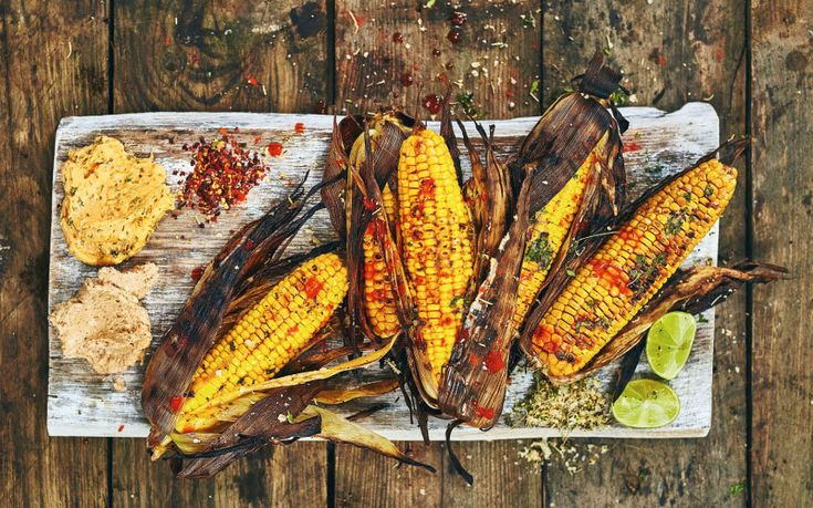Grill these corn on the cob on the BBQ, with their husks and some flavoured   butter, for a mouthwatering toasty flavour