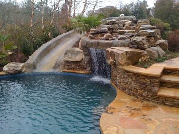 Inground Pools With Waterslides fancy stone inground pool water slide | custom pool water slides