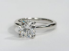 Enduring and elegant, this solitaire engagement ring is crafted in platinum with a rounded inside edge for comfort. Pair with the matching wedding band for the perfect set.