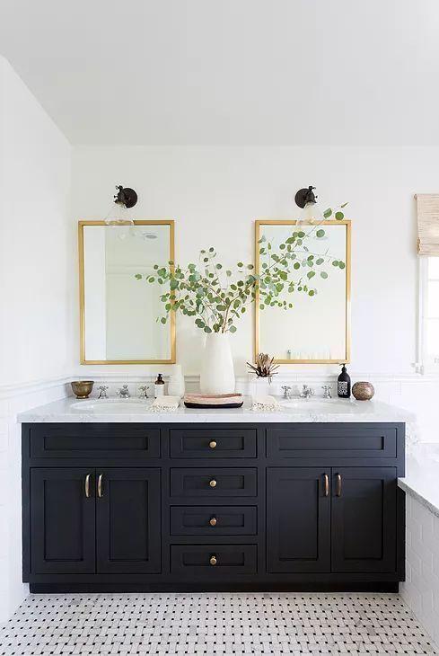 Black bathroom double sink vanity with brass hardw…