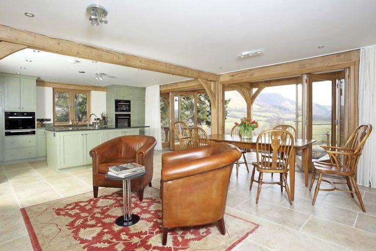 post and beam open plan kitchen area great space. #postandbeam #beams #oak #greenoak #oakframe #wood #home #house #dream #relax #kitchen