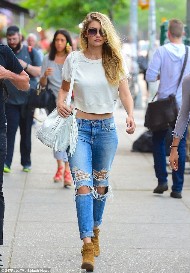 All-American girl: Gigi Hadid bared her taut tummy in ripped blue jeans while strolling through Manhattan's Soho neighbourhood Wednesday