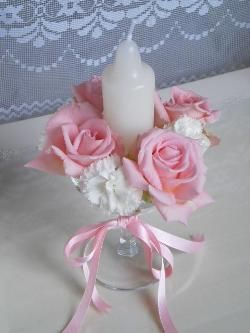 Wine glass with flowers and candle arrangement