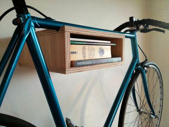 Basic wooden bike rack. Small bike storage cabinet. Wall mounted bike display bookshelf combination. Plywood.