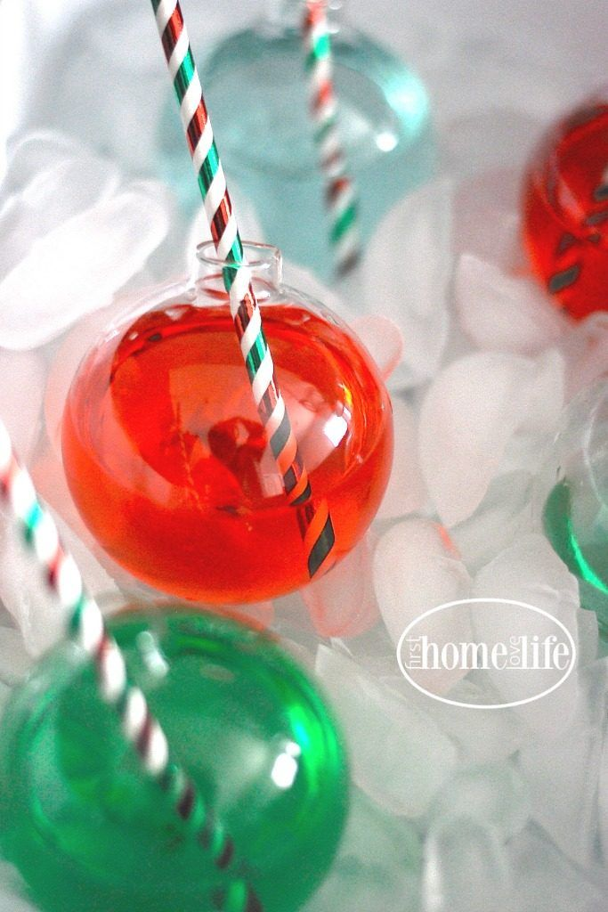 USE CLEAR ORNAMENTS AS DIY CHRISTMAS CUPS | FOR MORE FESTIVE HOLIDAY PARTY IDEAS AND DECOR VISIT FIRSTHOMELOVELIFE.COM