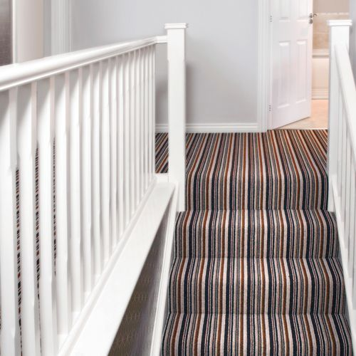 Cheltenham Stripe Royal Blue A simple white hallway is completely changed by laying a colourful striped carpet.