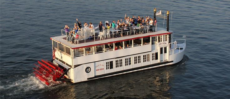 Captured from above the guests of a public cruise on lake