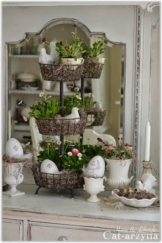 Beautiful tiered metal basket stand filled with miss, english daisies & roosters.