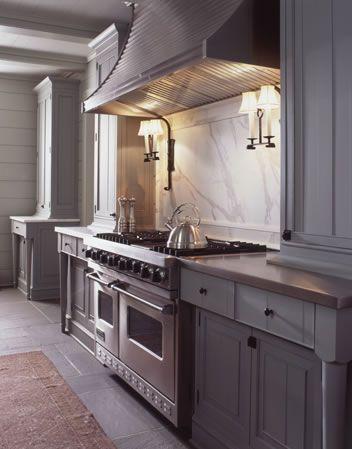 grey kitchen, cararrra marble backsplash, sconces above range Pursley Dixon