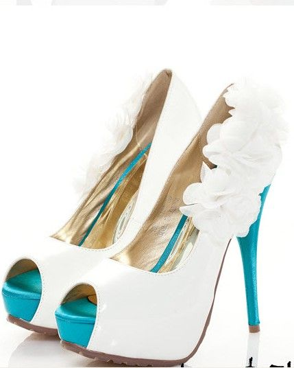 I'm in love with these!!! Maybe get some cheap white pumps and paint the tip and heel red to match my wedding colors.   Something Blue Flower Embellish High-heeled Wedding Shoes $430