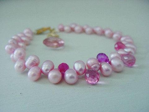 Pink dancing freshwater pearl and rose quartz bracelet with extender chain to fit most sizes.