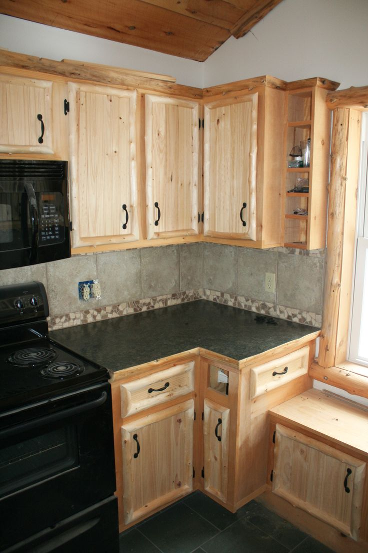 17 best images about kitchen cabinets on pinterest for Log cabin kitchen backsplash ideas
