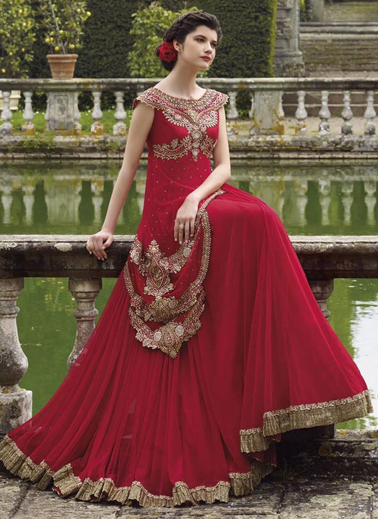 Featuring Haute couture red georgette gown beautified with heavy resham and zari embroidery and patch work. It is paired with matching shatoon bottom material and net duppata.This outfit can be stitched upto size 44. For stitching enquiries, please email us at customercare@hunardesigns.com   …