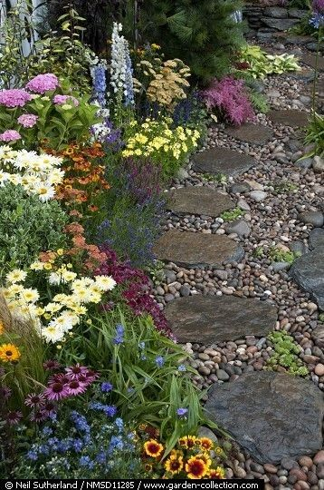 Stone pathway..... This would look really awesome in the backyard going down towards the ravine.  Maybe a little sitting area to relax and to get a little closer to nature.  We could sit down there in addition to the front porch or the deck.