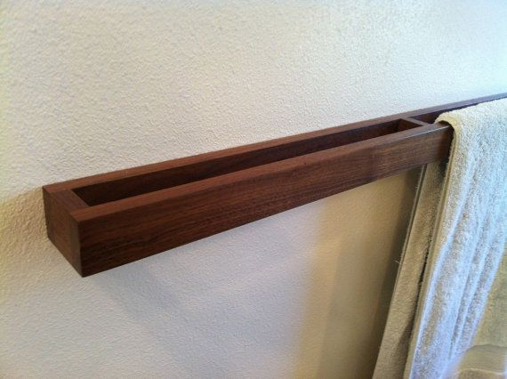 MODERN Walnut TOWEL BAR This unique towel holder is a must for your bathroom. - dimensions : 34 x 2 x 1.5 - mounting screws and anchors included - Installed: key hold fasteners If you are interested in a different size or WOOD I would be happy to accommodate your request when available.