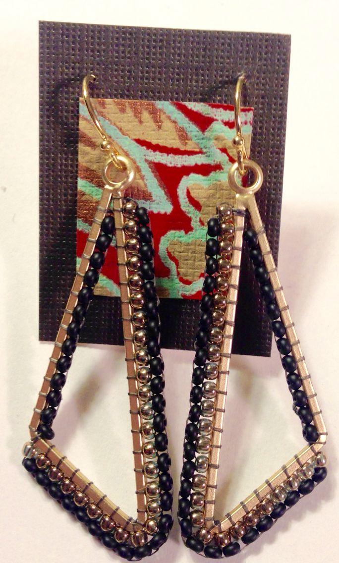Brass and black brick stitched creation