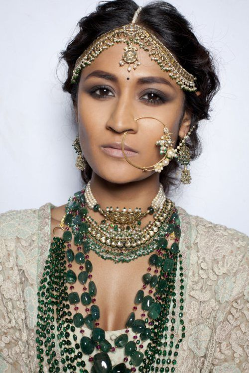 Sabyasachi. I don't very much care for the long necklaces but the head ornament and the chokers are really nice.