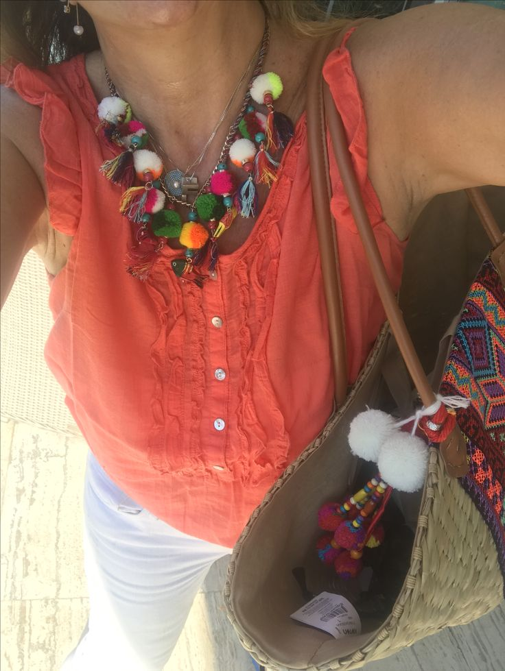 Matching necklace and bag.
