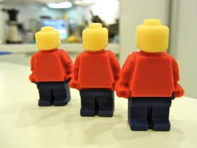 Lego minifigure candy...tutorial on using different color candy melts. Use as cupcake topper.