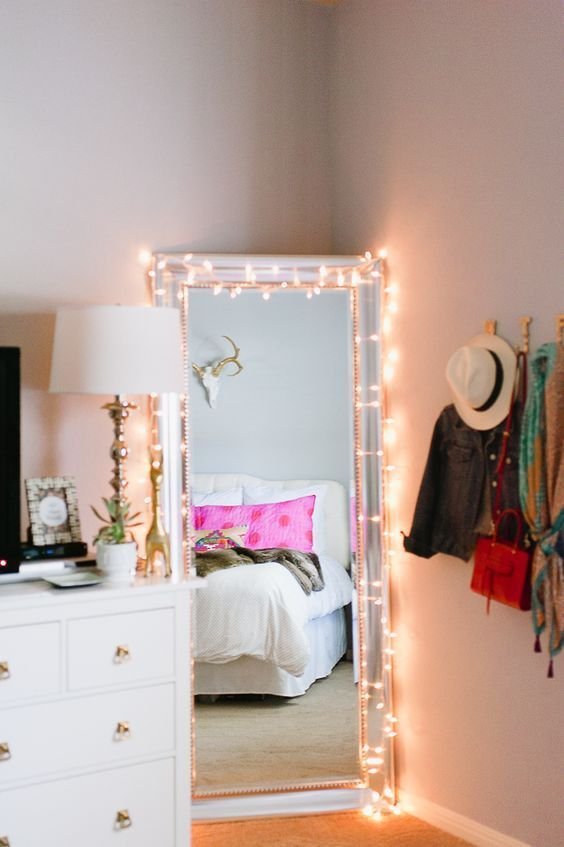 How cute is this!! A super easy way to brighten up any drab dorm room. Just drape the christmas lights around the mirror, and ta-da! It looks just like the mirror Kylie Jenner showed off in her snapchat! Check out more dorm decorating tips - 15 Tips To Create A Tumblr Dorm Room That'll Make Anyone Jealous #christmaslightsinthebedroom