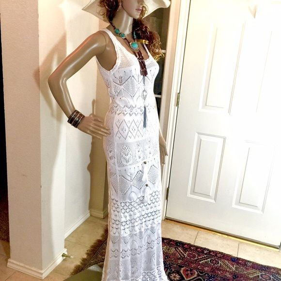 """Weekend SpecialNWOT Boho Crochet Festival Dress White crochet maxi in the Free People/ Spell & The Gypsy style. Pristine. A stretchy size small and probably best on 5'6 and taller unless you're into 3""""+ platforms. Bust un-stretched is 17"""" and can stretch to 20"""". Adjustable drawstring waist with nice tassel detail. Length is 61 1/2"""".  Comes with under slip. Weekend Special Price Firm unless bundled.  Dresses Maxi"""