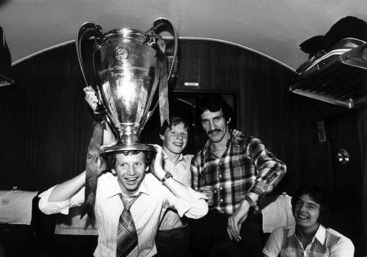 Liverpool FC player David Fairclough with the European cup on his head on the train journey home after beating Bruges 1-0. 1978