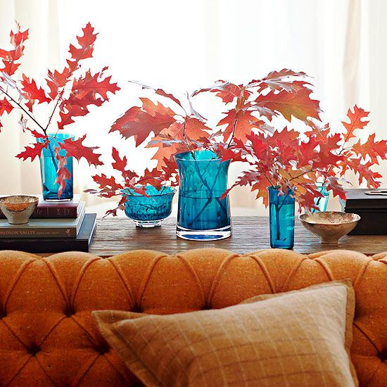 Red Leaves in Blue Vases. Pretty! More creative fall centerpiece ideas: http://www.bhg.com/halloween/decorating/creative-fall-centerpieces-featuring-natural-elements/