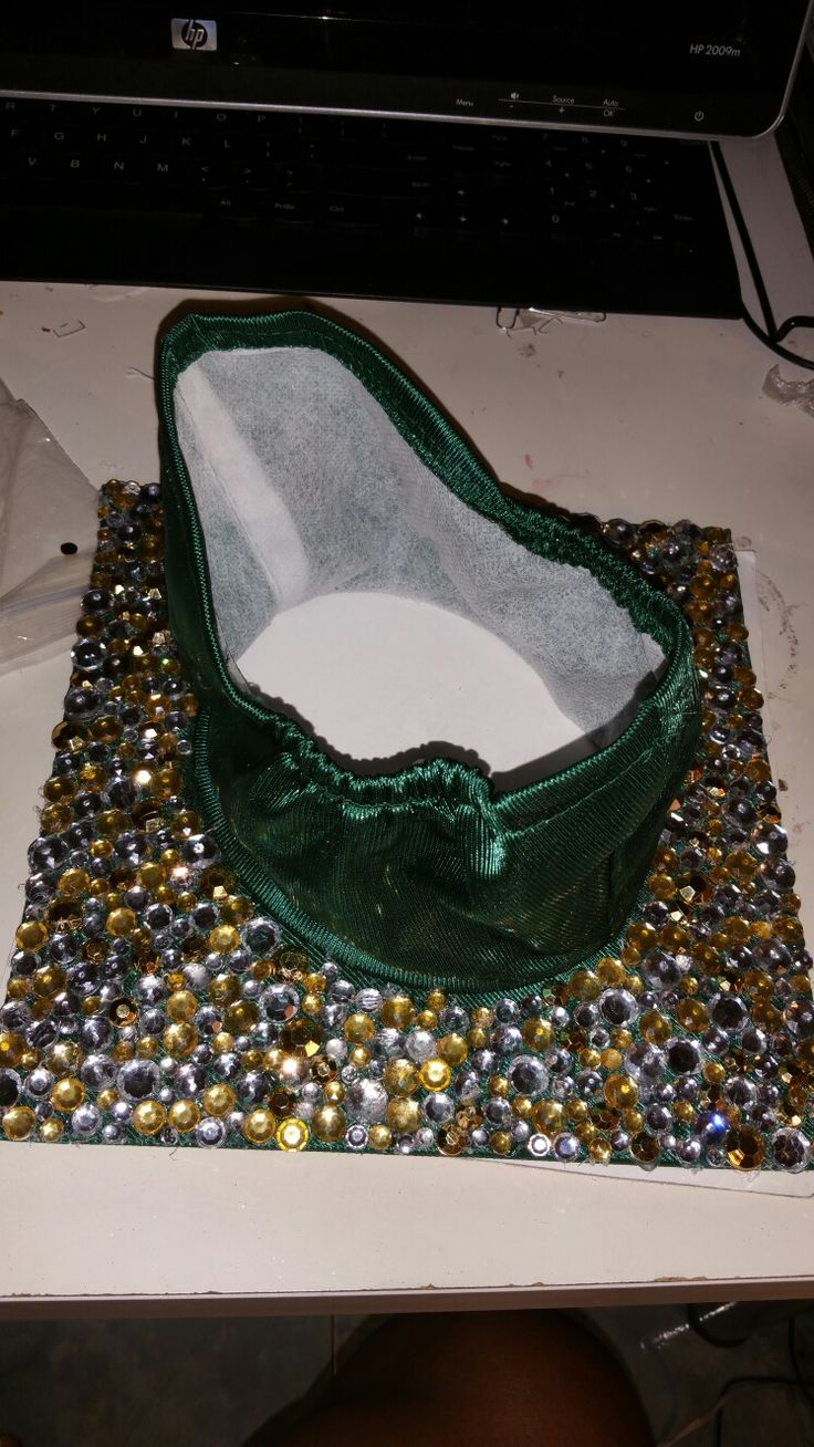 Ornate bedazzled rhinestone gemstone graduation cap. Bedazzle the bottom of the end cap.