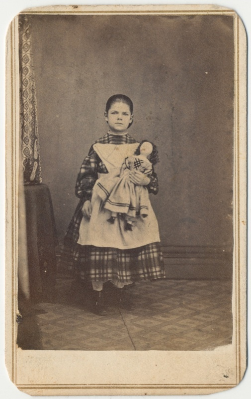 Young Girl Holding Doll, Ohio, 1863.