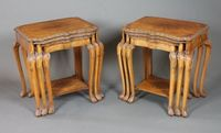 """In the style of Maple & Co. an unusual pair of early 20th  Century burr walnut table nests in the early 18th Century taste  having foliate carved shaped tops, raised on bell flower and  rosette carved cabriole legs, scroll feet, the largest 24.5""""h x 24""""w  x 18""""d   ILLUSTRATED SOLD FOR £640"""