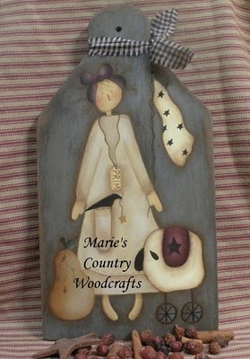Annabelle and her prims.Hand painted prim bread board.