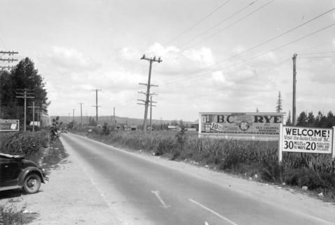 Harry Duker Company billboard advertising B.C. Rye and Old Colonel Bourbon on Pacific Highway, 100 feet from customs on the south side, 1931. (Photo via Vancouver Archives)