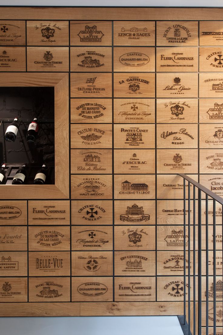 2100 Engraved Oak Panels Line The Walls Of This New Wine Shop